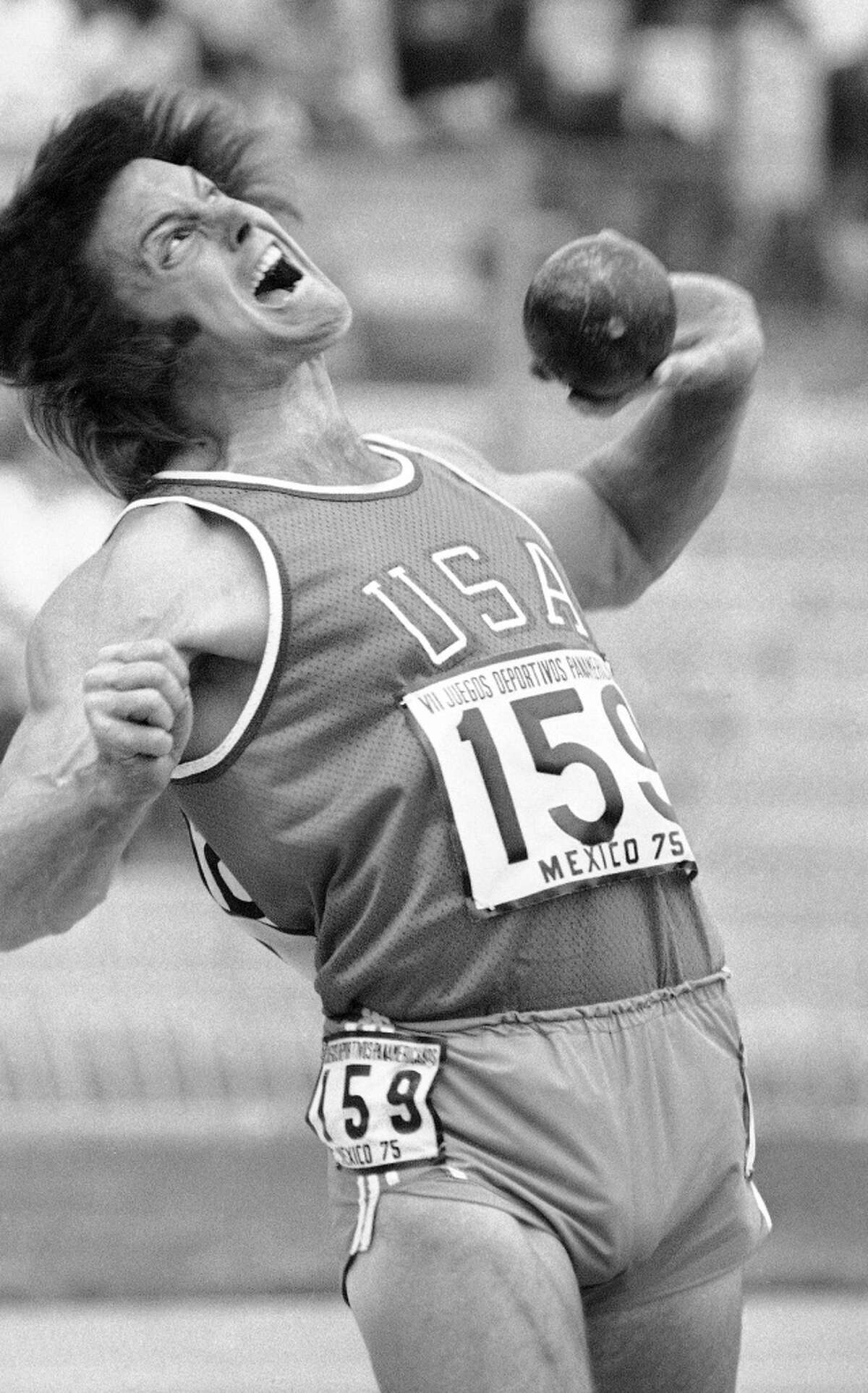 FILE - In this Oct. 11, 1975, file photo, Bruce Jenner, of the United States, strains as he throws the shot put in the decathlon competition at the Pan Am Games in Mexico City. Jenner made his debut as a transgender woman on the cover for the July 2015 issue of Vanity Fair. (AP Photo/File)