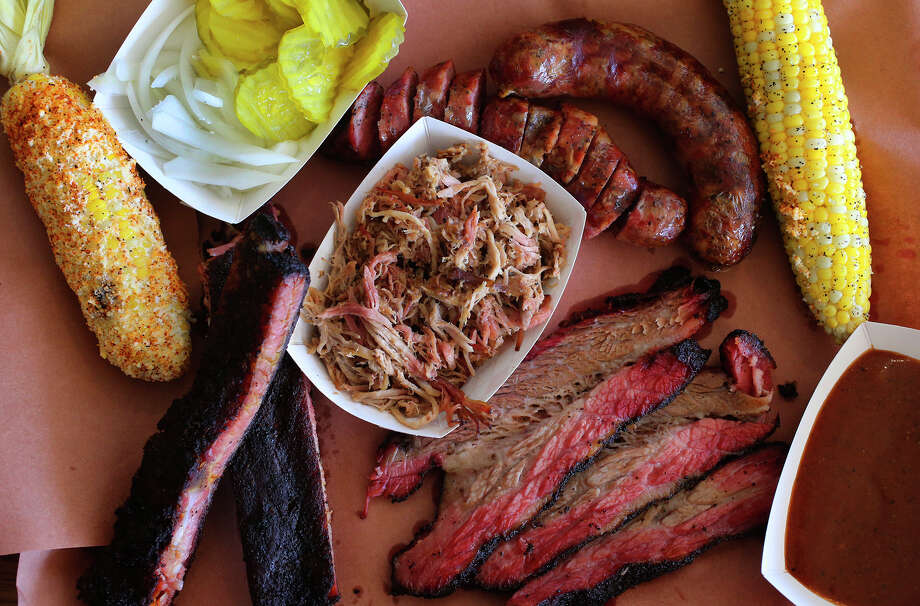 An assortment of dishes at Burnt Ends restaurant. Clockwise from upper left: helote mexicano, pulled pork, housemade sausage, smoked corn and brisket. Photo: John Davenport /San Antonio Express-News / ©San Antonio Express-News/John Davenport