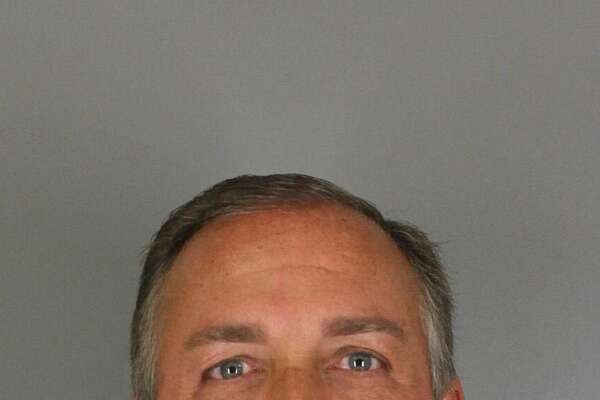 Former Jefferson County District Judge Layne Walker, 51, is charged with abuse of official capacity.