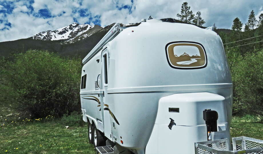 Snow-capped Mount Royal is like the peaks on the logo of the Oliver Legacy Elite II travel trailer boondocking in a relative's front yard in Frisco, Colo., where the temperature dipped to 34 at night. Photo: John Goodspeed /For The Express-News