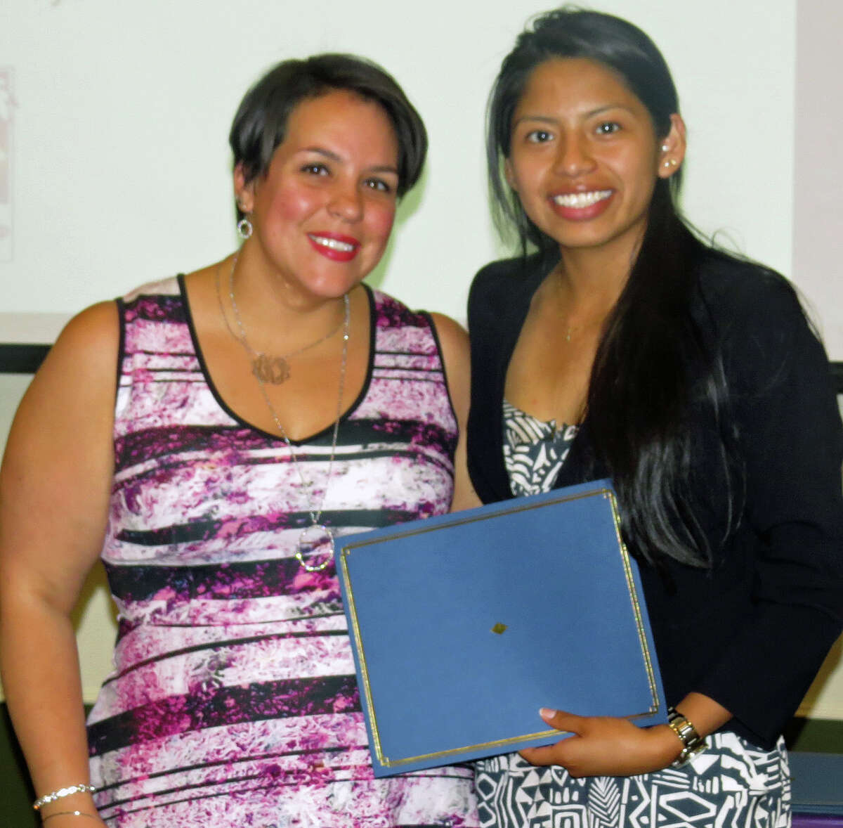 Abigail Kopp, chairwoman of the Latino Scholarship Fund, left, and Angelica Crespo, a scholarship winner from Danbury