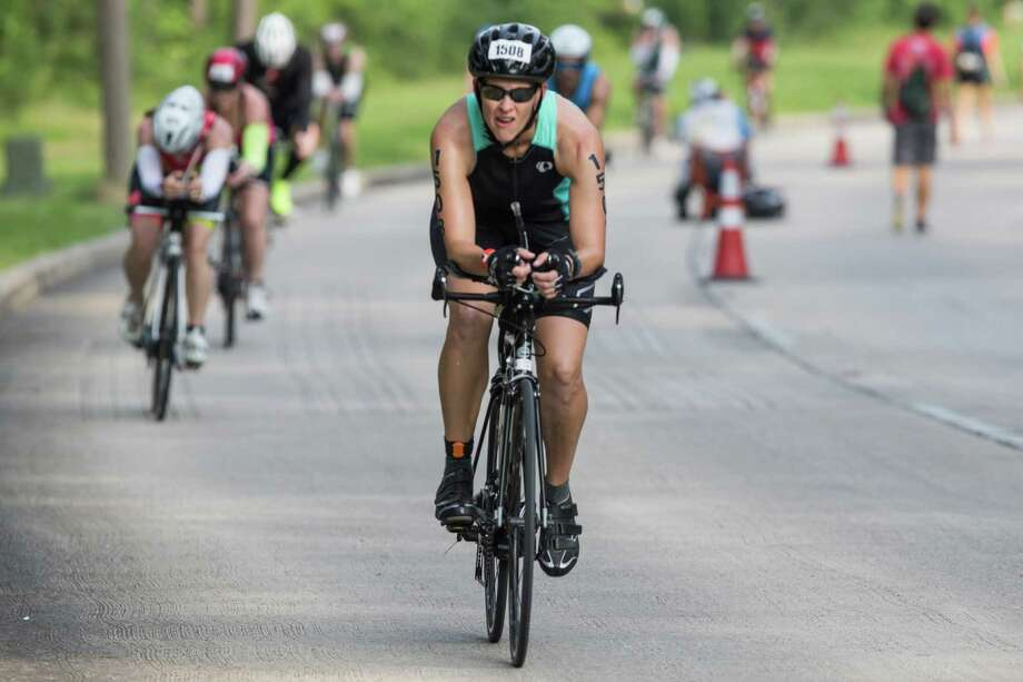 Kristi Odom rides during the Memorial Hermann Ironman North American Championship Texas triathon on Saturday, May 14, 2016, in The Woodlands. ( Brett Coomer / Houston Chronicle ) Photo: Brett Coomer, Staff / © 2016 Houston Chronicle