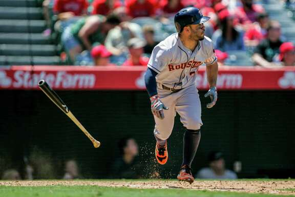 ANAHEIM, CA - JUNE 29: Jose Altuve #27 of the Houston Astros hits the ball in the 6th inning against the Los Angeles Angels at Angel Stadium of Anaheim on June 29, 2016 in Anaheim, California. (Photo by Kent Horner/Getty Images)