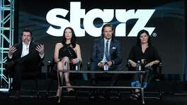 """Executive producer/showrunner Ronald D. Moore (from left), Caitriona Balfe, Sam Heughan and author Diana Gabaldon participate in the panel for """"Outlander"""" at the Starz 2016 Winter TCA in January. Film and TV studio Lions Gate said it is buying cable channel Starz in a deal worth $4.4 billion."""