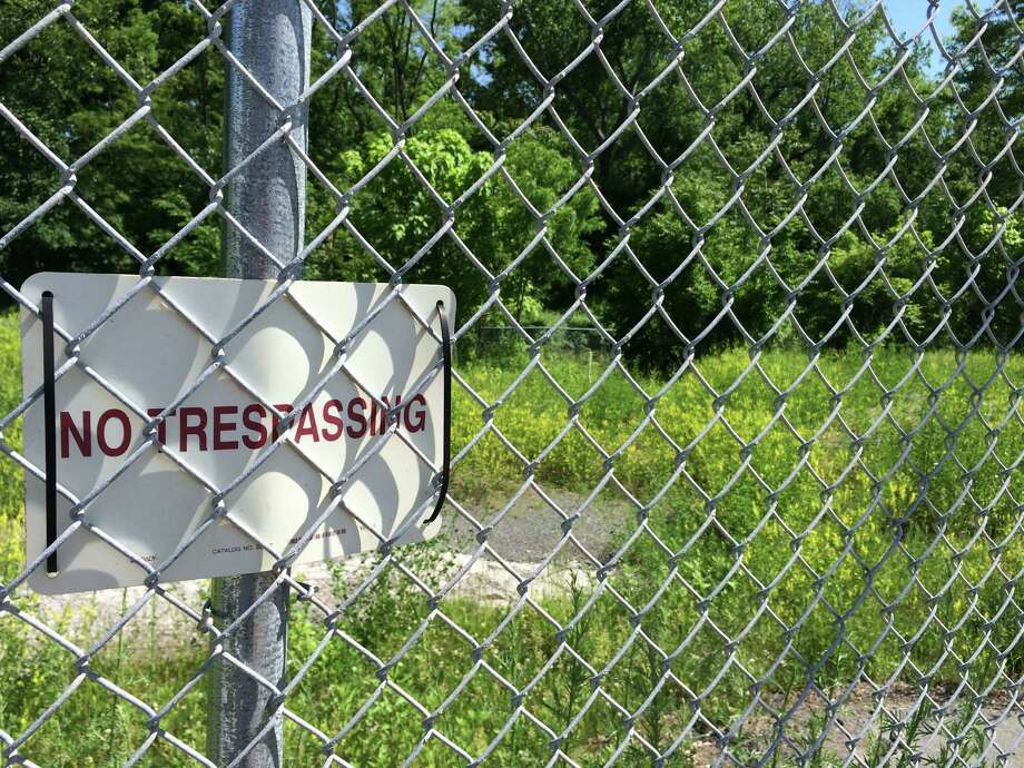 A Superfund site at 153-155 Saratoga Ave. Waterford as seen on May 31, 2016. A former cooperage, or barrell-making facility, it was demolished in the mid-1990s - but the site has never been fully cleaned of toxins, including PCBs. (Lauren Stanforth)