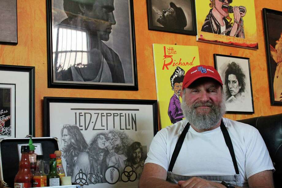 Rich Herzfeld, owner of Chef's Table, will be moving the popular eatery, along with all its rock and roll memorabilia, to a new location on the Post Road. Photo: Genevieve Reilly / Hearst Connecticut Media / Fairfield Citizen