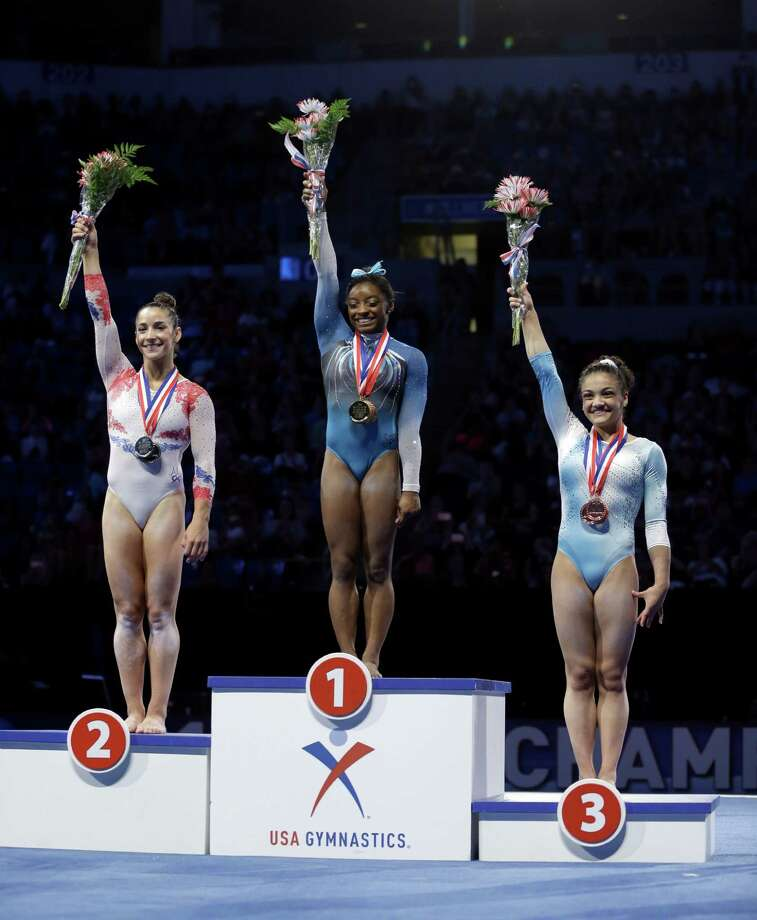 First place finisher Simone Biles, center stands on the podium with second place finisher Aly Raisman and third place finisher Lauren Hernandez during the U.S. women's gymnastics championships Sunday, June 26, 2016, in St. Louis. (AP Photo/Jeff Roberson) Photo: Jeff Roberson, STF / Copyright 2016 The Associated Press. All rights reserved. This material may not be published, broadcast, rewritten or redistribu