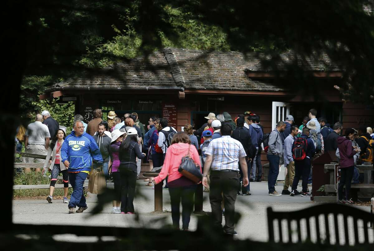 Visitors line up to pay the entrance fee at Muir Woods National Monument in Mill Valley, Calif. on Wednesday, June 29, 2016. The National Park Service is considering a plan to remove a parking lot and reduce a wide pedestrian area at the entrance to the park and restore the natural habitat along nearby Redwood Creek.