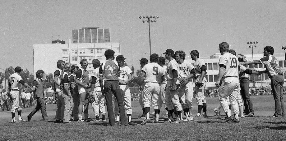 Players shake hands after a softball game between the gay community and the San Francisco Police Department on Aug. 10, 1975. Photo: Susan Ehmer, The Chronicle