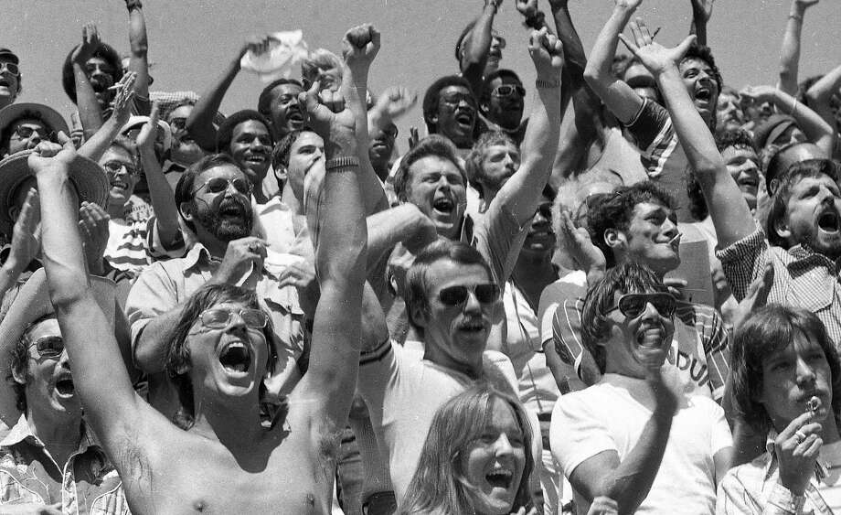 Fans cheer from the stands during the charity game between the Pendulum Pirates and the S.F. Police Department in 1975. Photo: Susan Ehmer, The Chronicle