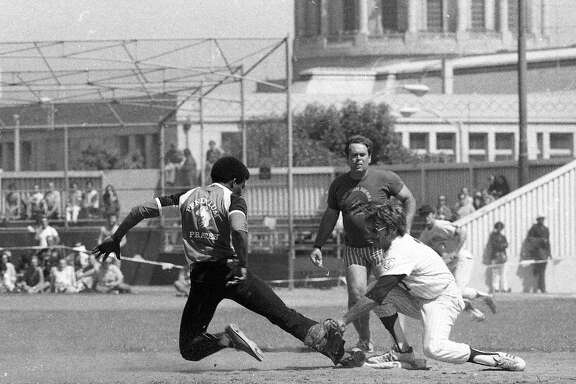 Aug. 10, 1975: A member of the Pendulum Pirates slides into the tag during a softball game between the gay community and the San Francisco Police Department.