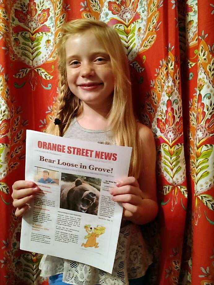 In this September 2015, photo provided by Matthew Lysiak, Hilde Kate Lysiak poses for a photo at her home in Selinsgrove, Pa. Lysiak, a 9-year-old reporter, recently wrote about a suspected murder in her small Pennsylvania town and is defending herself after some locals lashed out about a young girl covering violent crime. (Isabel Rose Lysiak via AP) Photo: Isabel Rose Lysiak, AP