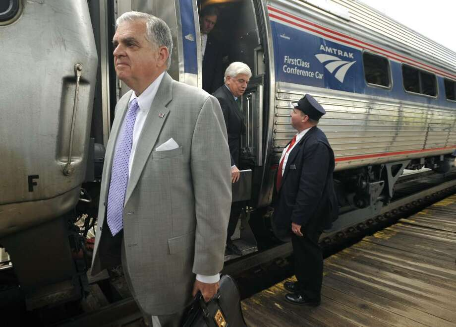 U.S. Transportation Secretary Ray LaHood, left, arrives with U.S. Sen. Christopher Dodd, stepping off car, by Amtrak train in Hartford, Conn., Monday, April 26, 2010. LaHood will be meeting with Connecticut officials to discuss proposed improvements to rail service between New Haven, Hartford and Springfield, Mass. (AP Photo/Jessica Hill) Photo: Jessica Hill, AP / AP2010