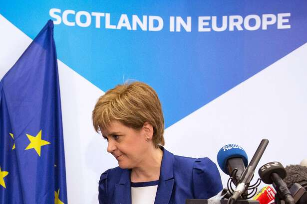 """Scotland's First Minister Nicola Sturgeon leaves after a media conference at the Scotland House in Brussels as she is on a one day visit to meet with EU officials, on June 29, 2016. Scotland's First Minister Nicola Sturgeon said she was """"heartened"""" by her talks with EU officials today but said there was no """"automatic easy path"""" to protecting her country's status in the EU after Brexit. / AFP PHOTO / POOL / Geoffroy Van der HasseltGEOFFROY VAN DER HASSELT/AFP/Getty Images"""