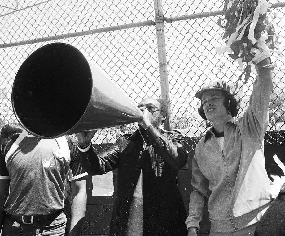 Willie Brown and Dianne Feinstein cheer during a charity softball game between the gay community and the San Francisco Police Department on Aug. 10, 1975. Photo: Susan Ehmer, The Chronicle