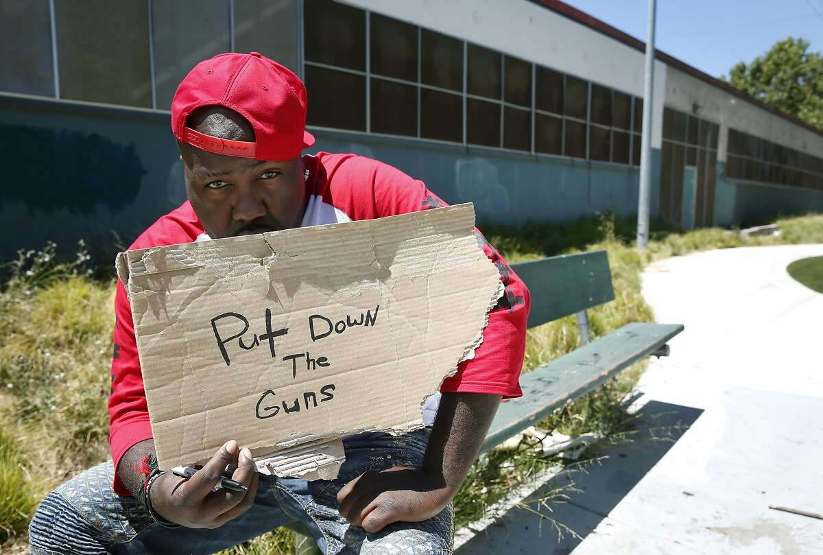 Rapper Mistah F.A.B. scrawled out a message when he visited Linden Community Park, where he spent his days as a youth, in Oakland, Calif. on Wednesday, June 29, 2016.