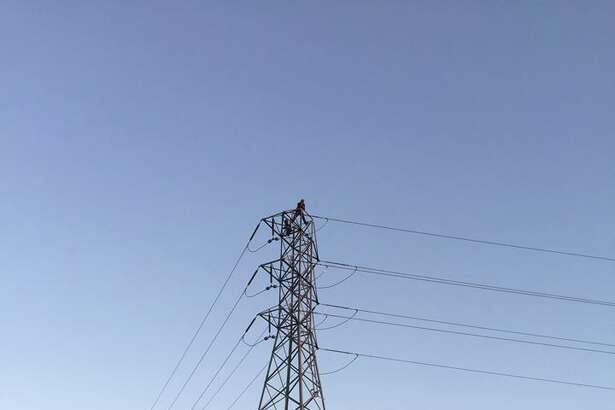 A 50-year-old homeless man perched on an electrical tower in Santa Rosa Wednesday evening prompted Pacific, Gas and Electric Co. officials to cut power to 22,000 residents in the area while police hostage negotiators talked him down.