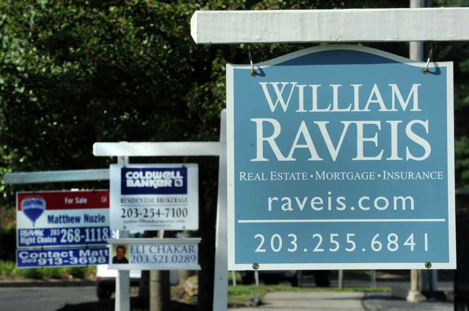 Multiple real estate signs line up along North Ave. in Bridgeport, Conn. Photo: Cathy Zuraw / Cathy Zuraw / Connecticut Post
