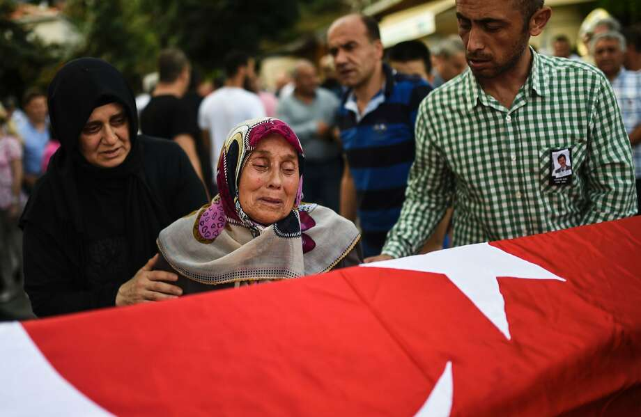 The grandmother of Turkish teacher Huseyin Tunc cries in front of his coffin two days after the suicide bombings and gun attack at Istanbul's airport. Photo: BULENT KILIC, AFP/Getty Images