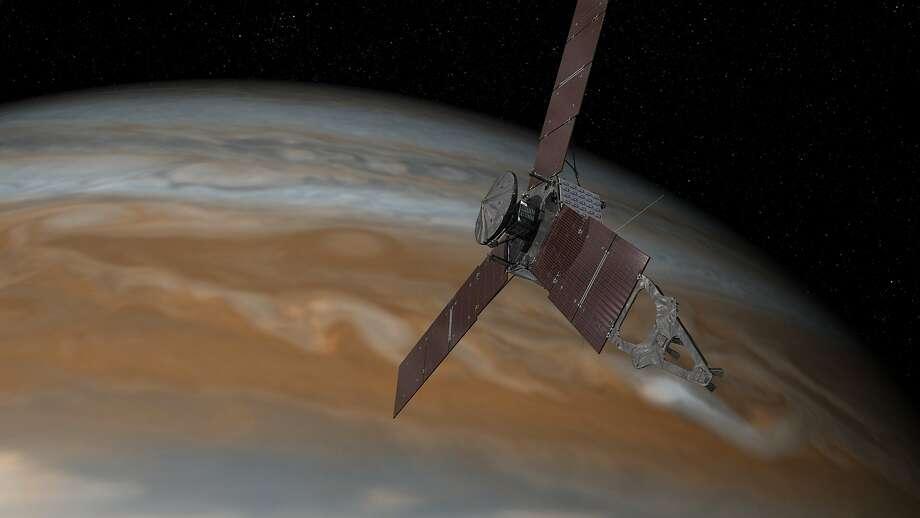 An artist's rendering shows the Juno spacecraft above Jupiter. Photo: Associated Press