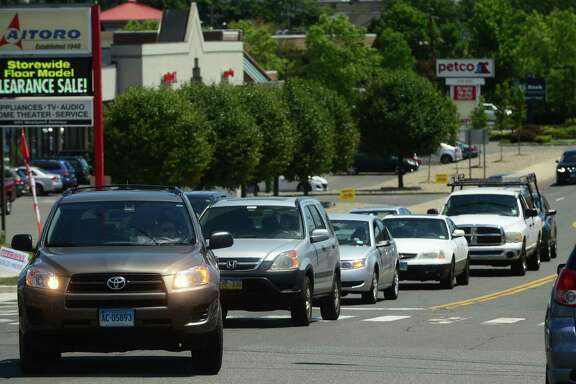 A driver tries to make a left turn onto  Strawberry Hill Ave. from Route 1 in Norwalk, Conn. Thursday, June 30, 2016. The Connecticut Department of Transportation presented Norwalk residents with improvement plans for the intersection at Route 1 and Strawberry Hill Avenue where Route 1 will be widened to accomodate opposing left-turn lanes.