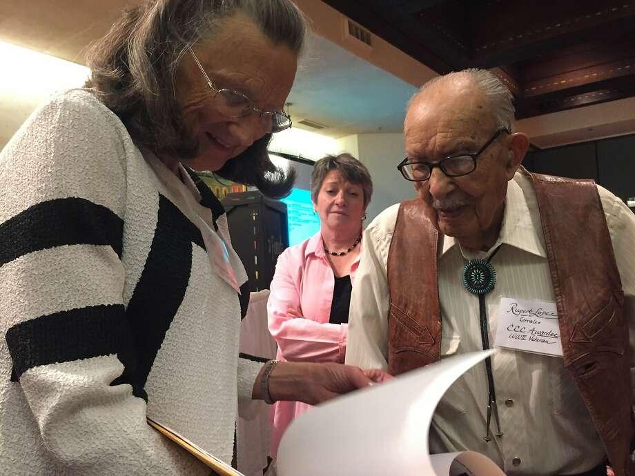 Former Civilian Conservation Corps laborer Rupert Lopez, 100, speaks with Nina Roosevelt Gibson, a granddaughter of President Franklin D. Roosevelt in Santa Fe, N.M Photo: Morgan Lee, Associated Press