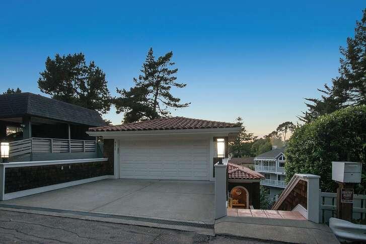 The hillside home has its front door below street level.