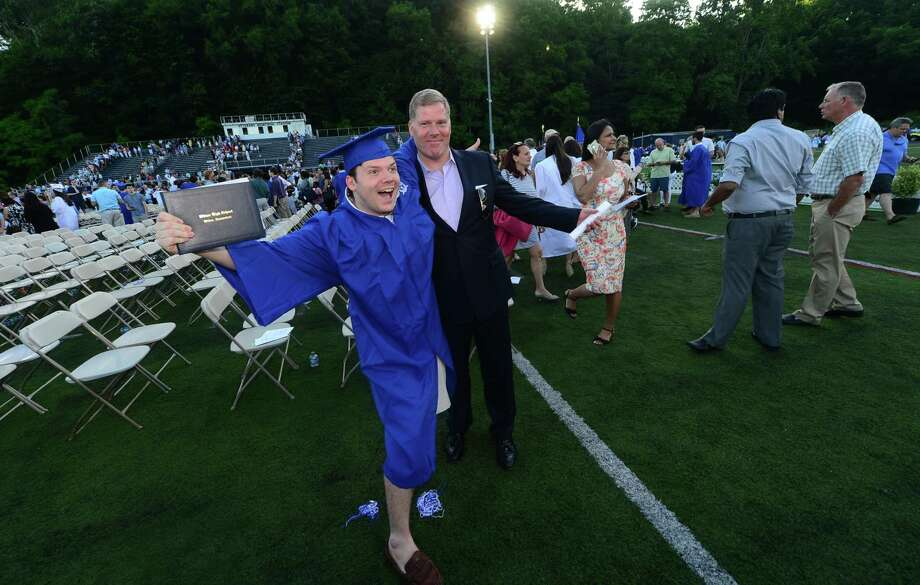 Wilton High School senior Christian Horner and his dad Rob Horner celebrate the graduation of the Class of 2016 during the commencement excercises Saturday, June 18, 2016, at Wilton High School in Wilton, Conn. Photo: Erik Trautmann / Hearst Connecticut Media / (C)2016, The Connecicut Post, all rights reserved