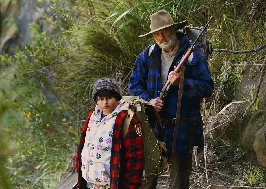 "This image released by The Orchard shows Julian Dennison, left, and Sam Neill in a scene from ""Hunt For The Wilderpeople."" (The Orchard via AP) Photo: Associated Press"