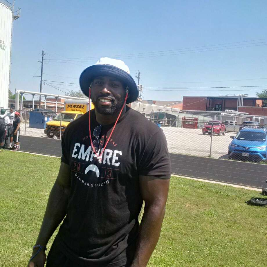 Texans outside linebacker Whitney Mercilus teaches the fundamentals of football and nutrition at his football camp Thursday at Stephen F Austin High School. Photo: Aaron Wilson / Houston Chronicle