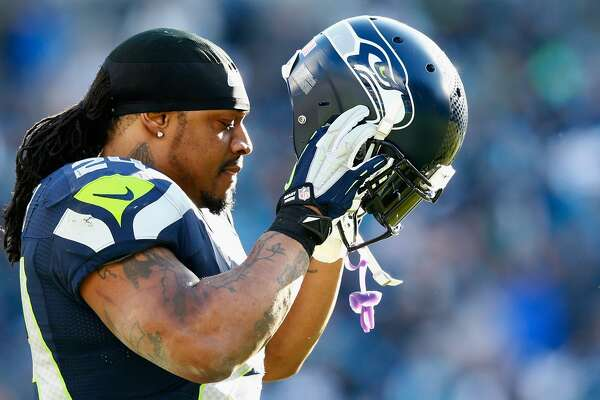 CHARLOTTE, NC - JANUARY 17:  Marshawn Lynch #24 of the Seattle Seahawks looks on during the third quarter of the NFC Divisional Playoff Game against the Carolina Panthers at Bank of America Stadium on January 17, 2016 in Charlotte, North Carolina.  (Photo by Jamie Squire/Getty Images)