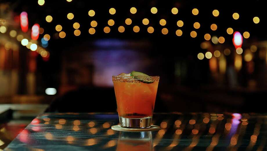 The El Guapo Viejo cocktail at Goode Co. Armadillo Palace. The popular restaruant/bar/music venue is holding a party July 2 to celebrate its expansion that includes a new bar, dance hall and patio. Photo: James Nielsen, Houston Chronicle / © 2016  Houston Chronicle
