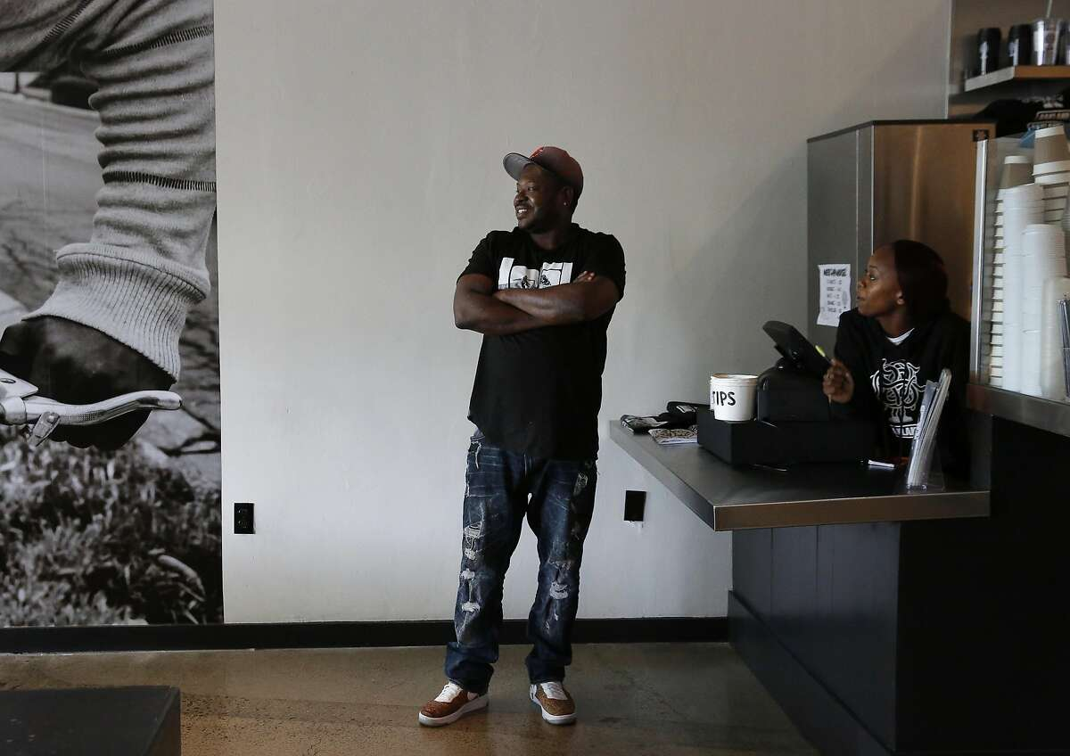 Keith Corbin, Director of Operations, left, chats with General Manager Devignai Carroll as they wait for the next customer in LocoL restaurant June 29, 2016 in Oakland, Calif.