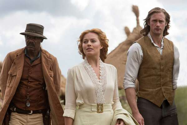 "This image released by Warner Bros. Entertainment shows, from left, Samuel L. Jackson, Margot Robbie and Alexander Skarsgard in a scene from ""The Legend of Tarzan."" (Jonathan Olley/Warner Bros. Entertainment via AP) ORG XMIT: NYET725"