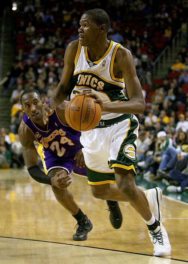 Kevin Durant, driving past the Lakers' Kobe Bryant in a January 2008 game at Key Arena, was taken second overall by the Sonics in 2007. In his second season in the league, the franchise moved to Oklahoma City and became the Thunder. Photo: Scott Eklund, Seattle Post-Intelligencer