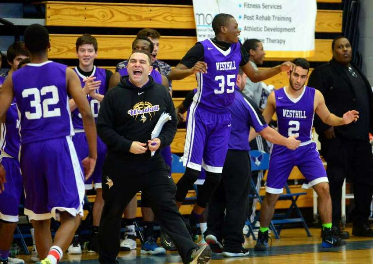 Westhill High School assistant basketball coach Jose Amor, center, was charged Wednesday with hindering prosecution. He is accused of alerting one of his players about being a prime suspect in a West Side shooting.