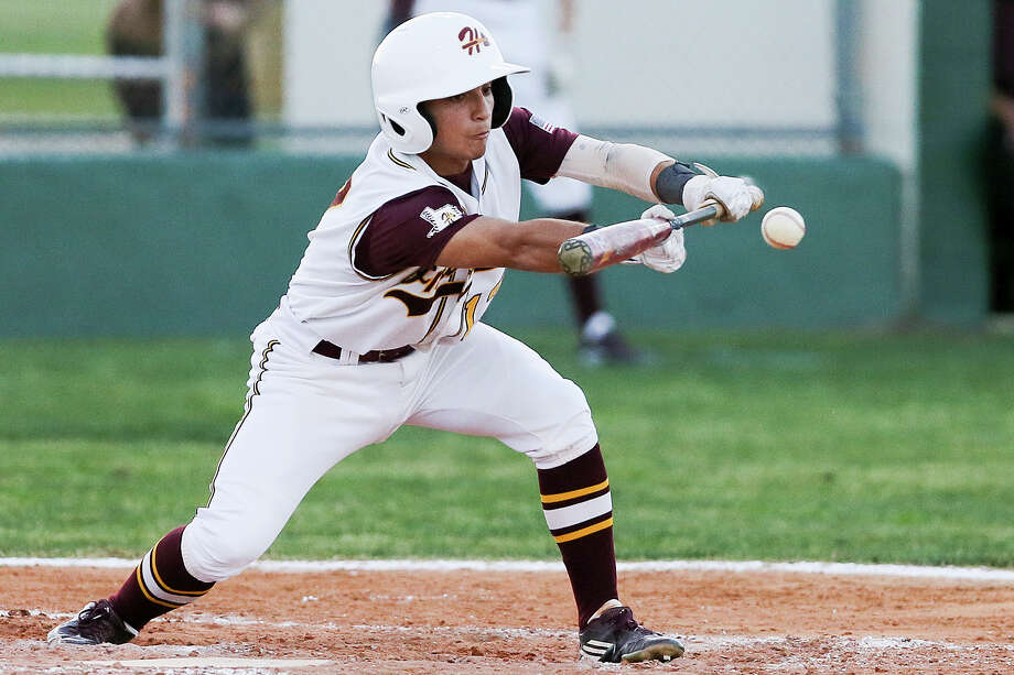 Harlandale catcher Christian Slocume was named to the Texas High School Baseball Coaches Association's Class 5A third team. Photo: Marvin Pfeiffer / San Antonio Express-News / Express-News 2016