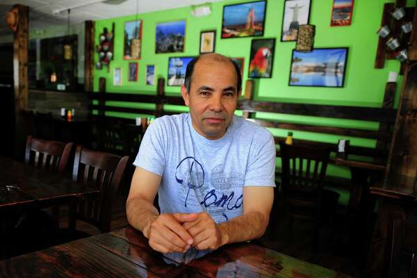 Owner Manny Olivares poses at Rancho Pantanal, a new Brazilian restaurant which opens Friday on Boston Post Road in Bridgeport, Conn., on Wednesday June 29, 2016.