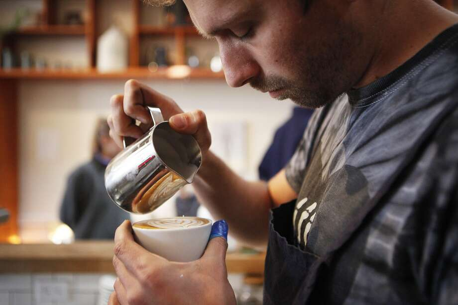 Adam McKenzie of San Francisco prepares a latte on Thursday, June 30, 2016 at the The Mill in San Francisco, California. San Francisco has been on the forefront of the push to raise minimum wage levels, but the push to raise wages for the worst-paid workers may mean more elsewhere. Photo: Michael Noble Jr., The Chronicle