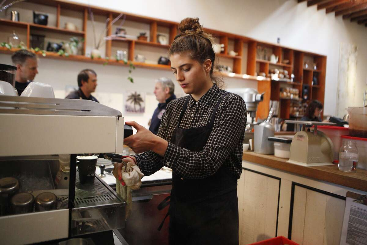 Annie Averill of San Francisco prepares drinks on Thursday, June 30, 2016 at the The Mill in San Francisco, California. San Francisco has been on the forefront of the push to raise minimum wage levels, but the push to raise wages for the worst-paid workers may mean more elsewhere.