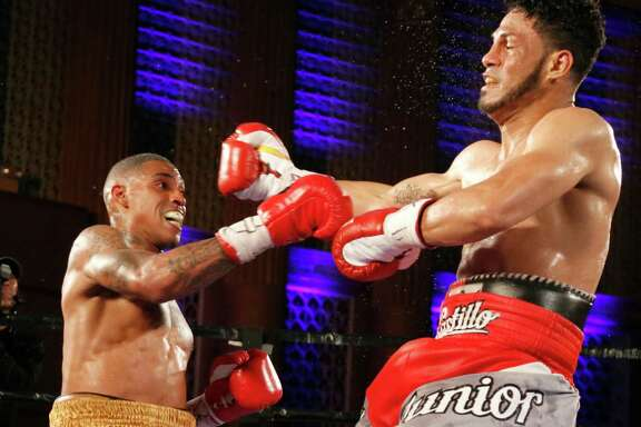 Justin DeLoach (left) punches Junior Castillo in their fight on June 25, 2016 at the Scottish Rite Auditorium in San Antonio. The boutwas part of Premier Boxing Champions card.