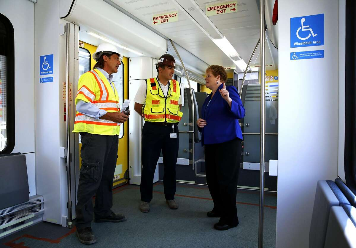 BART engineers Tony Candotti (left) and Carlos Melendez speak with BART General Manager Grace Crunican during a tour of BART's new train car in Antioch, California, on Thursday, June 30, 2016.