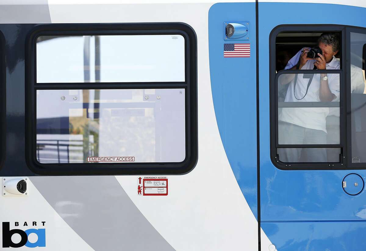 J�rg Zbinden of Stadler Rail takes a picture during a presentation beside BART's new train car in Antioch, California, on Thursday, June 30, 2016.