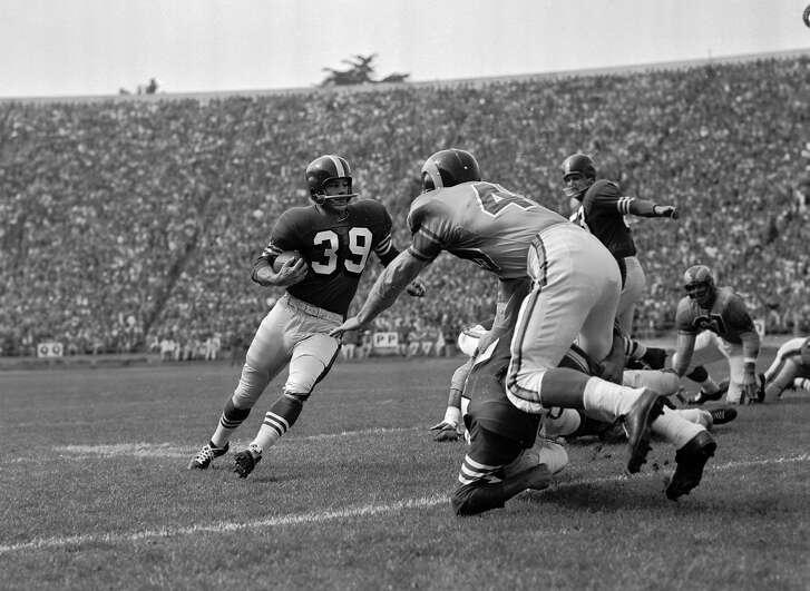 Hugh McElhenny, San Francisco 49er halfback, gains 8 yards against the Los Angeles Rams, Sept. 25, 1955, at Kezar Stadium in San Francisco.  (AP Photo)