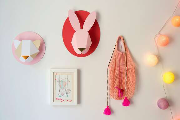 The girls� room gets a playful touch from Chloe�s fox and bunny paper taxidermy.