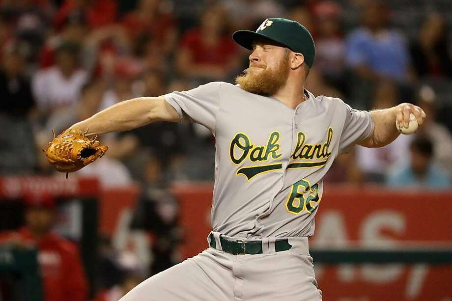 ANAHEIM, CA - JUNE 25:  Sean Doolittle #62 of the Oakland Athletics pitches during the ninth inning of a baseball game against the Los Angeles Angels of Anaheim at Angel Stadium of Anaheim on June 25, 2016 in Anaheim, California.  (Photo by Sean M. Haffey/Getty Images) Photo: Sean M. Haffey, Getty Images