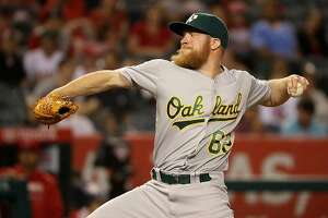 ANAHEIM, CA - JUNE 25:  Sean Doolittle #62 of the Oakland Athletics pitches during the ninth inning of a baseball game against the Los Angeles Angels of Anaheim at Angel Stadium of Anaheim on June 25, 2016 in Anaheim, California.  (Photo by Sean M. Haffey/Getty Images)