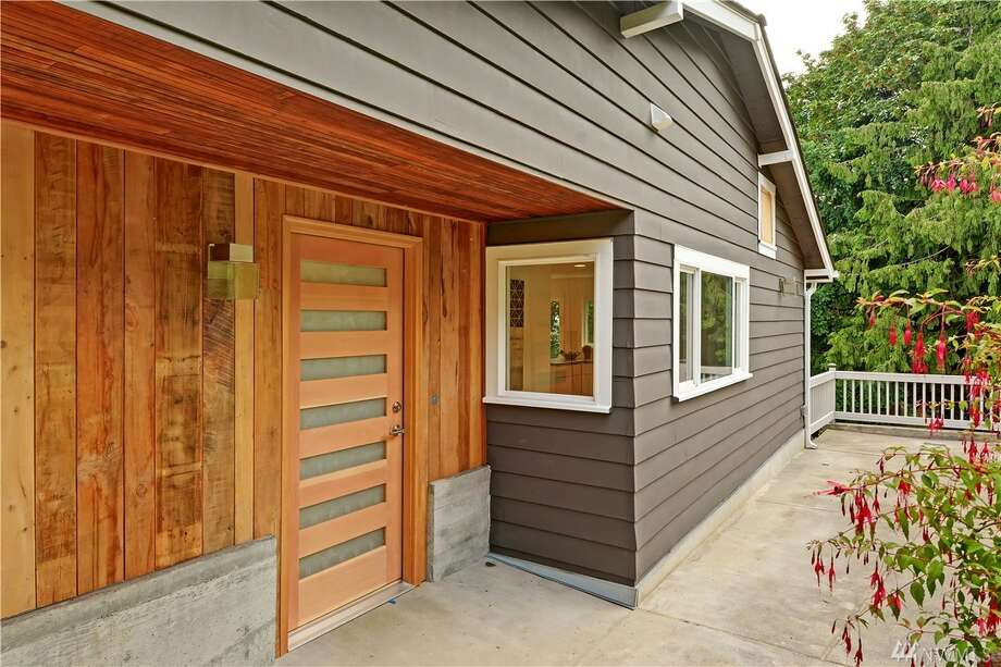 The first home, 6211 51st Ave. S., is listed for $799,000. The four bedroom, three bathroom home was built in 1919 but has completely remodeled and updated by Permian Builders, a South Seattle design company.The home features timber from the original structure, salvaged and repurposed materials throughout and a brand new roof, plumbing system and kitchen. You can see the full listing here. There will be a showing for this home on Saturday, July 2 and Sunday, July 3 from 1 - 4 p.m. Photo: Sabranie Coyne, Windermere R.E. Mount Baker