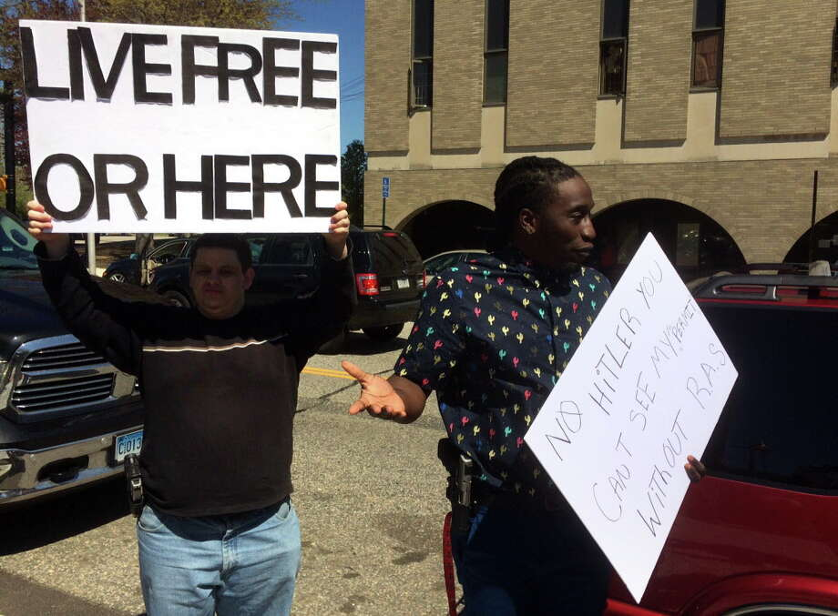 Dontrell Brown, right, is shown protesting in April outside the Bridgeport Police Department. Brown was arrested on Thursday, June 30, when police said he tried to bring loaded weapons into the Golden Hill Street courthouse. Photo: Dan Tepfer / Hearst Connecticut Media / Connecticut Post