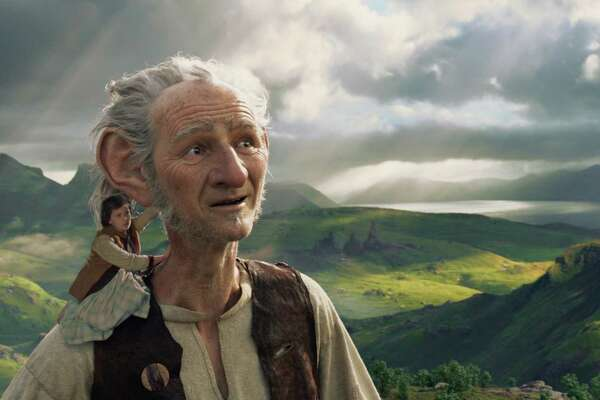"""Sophie (Ruby Barnhill) accompanies the BFG (Mark Rylance) to Giant Country in """"The BFG."""""""